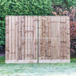 Pair of closed board driveway gates