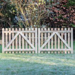 Pair of round top picket gates